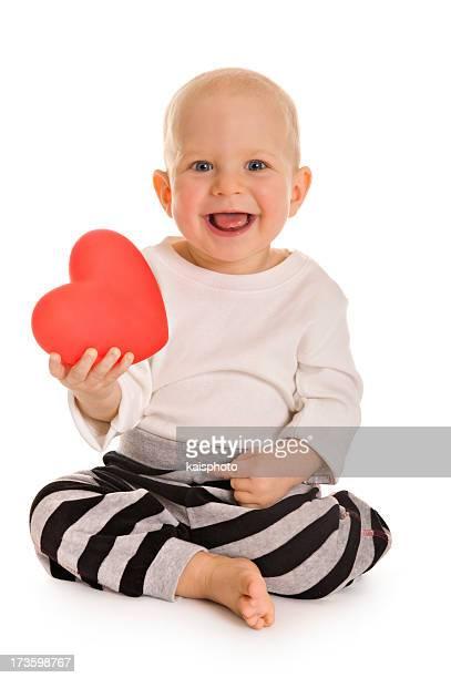 Little boy holding a heart