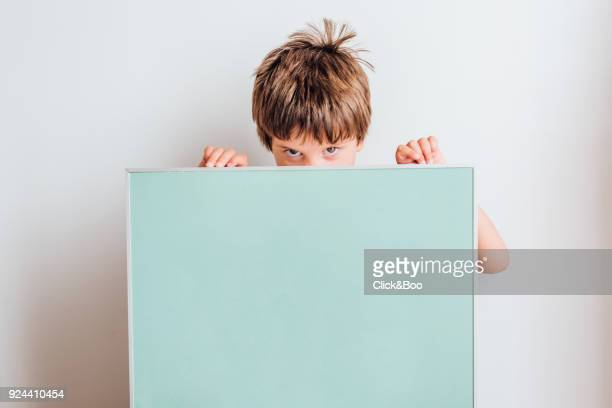 Little boy holding a poster