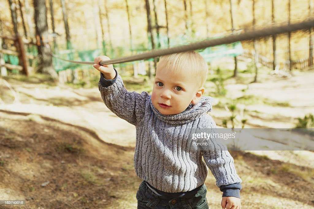 little Boy holding a rope at a High Rope Course : Bildbanksbilder