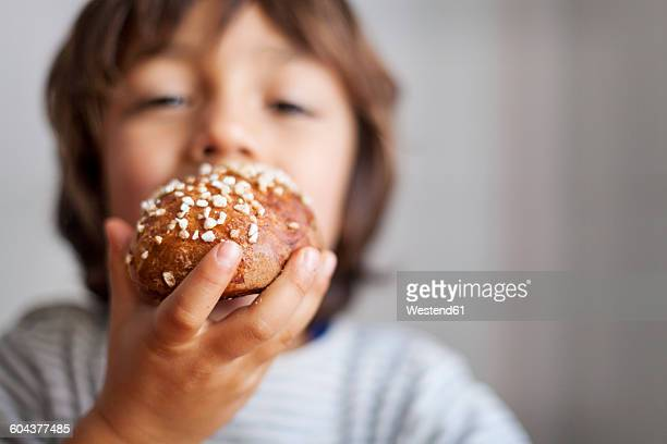 Little boy holding brioche