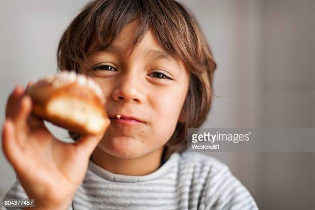 little boy holding brioche - brioche stock pictures, royalty-free photos & images