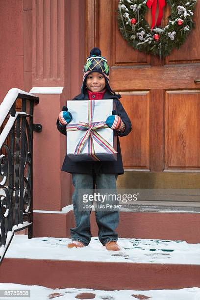 Little boy holding present