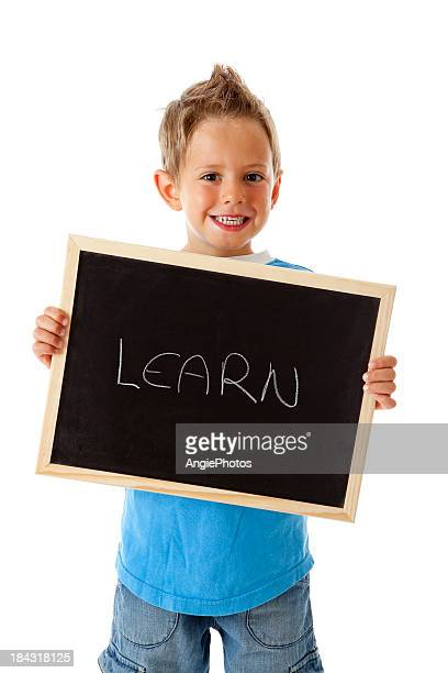 Little boy holding sign with the word learn