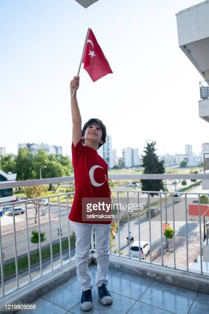 little boy holding turkish flag for celebration of national sovereignty and children's day - one boy only stock pictures, royalty-free photos & images