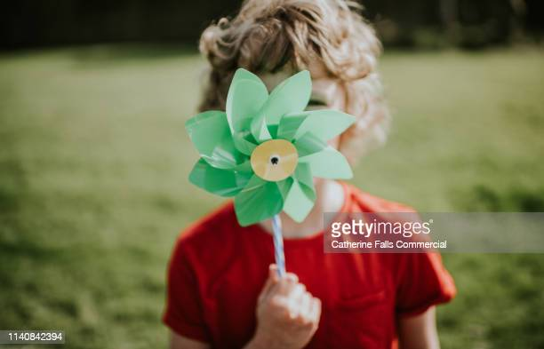 little boy holding windmill - energy efficient stock pictures, royalty-free photos & images