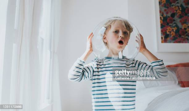 little boy imagines he's an astronaut - astronaut stock pictures, royalty-free photos & images