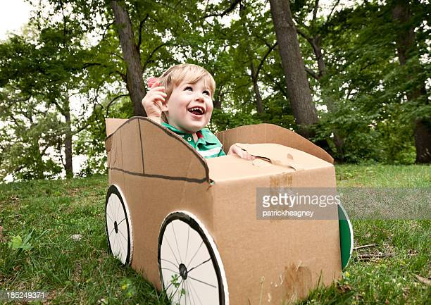 Little Boy in a Cardboard Car