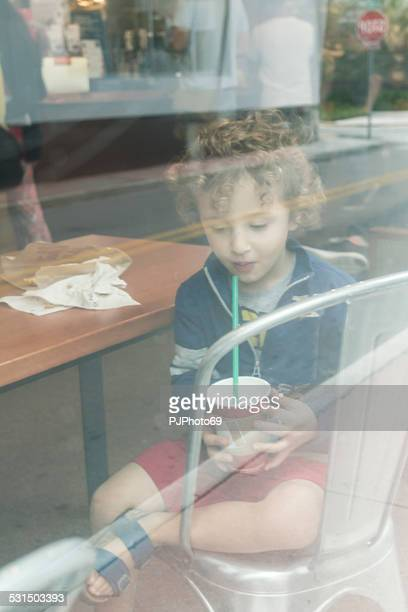 Little boy in a internet cafe