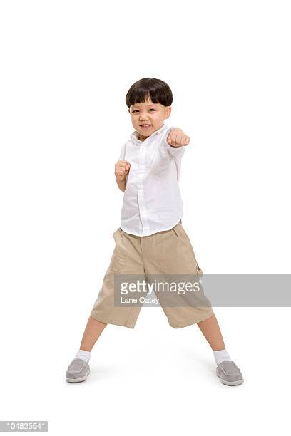 little boy in a kungfu pose - fighting stance stock pictures, royalty-free photos & images