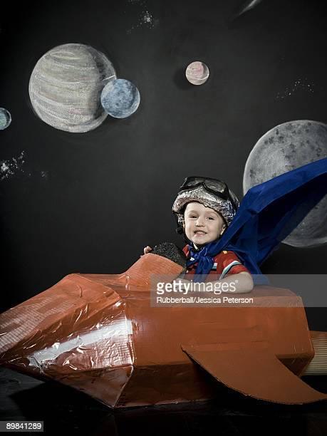 little boy in a rocketship