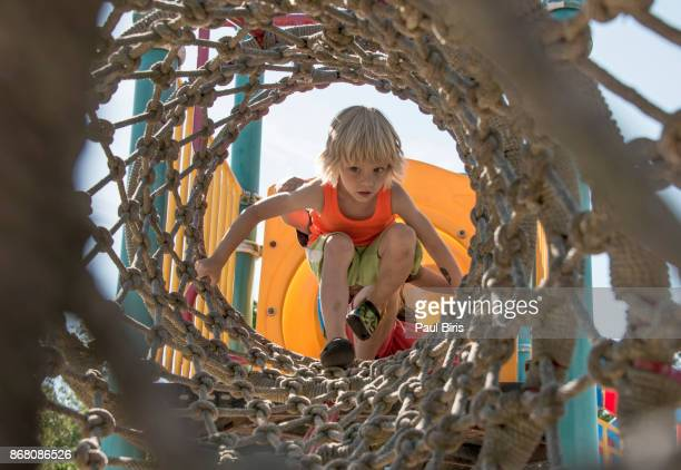 little boy in amusement park rope tunnel - denmark stock pictures, royalty-free photos & images