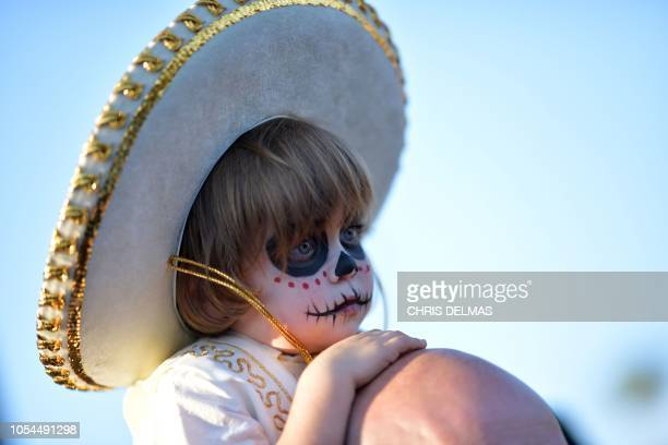 A little boy in costume attends Hollywood Forever Cemetery's 19th annual Dia De Los Muertos event on October 27 2018