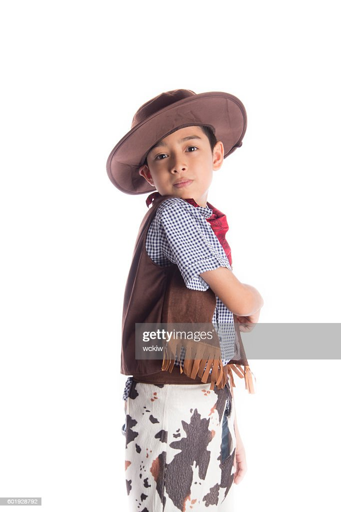 8e3c07ef766f2 Little boy in cowboy costume on white background   Stock Photo