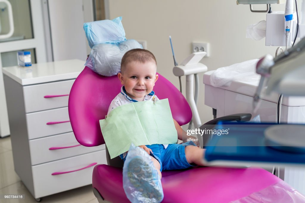 Little boy in dentistry, sitting in chair : Stock Photo