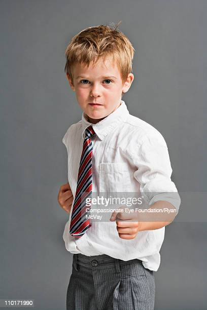 little boy in dress clothes with his fists up - fighting stance stock pictures, royalty-free photos & images