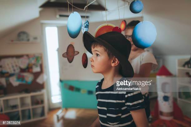 little boy in kindergarten - astronomy stock photos and pictures