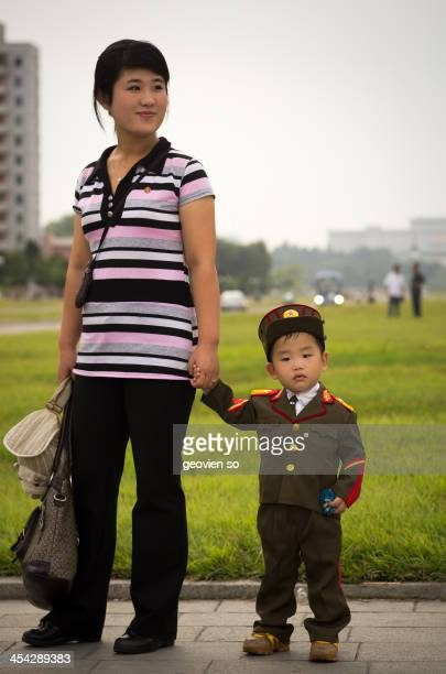 Little boy in military uniform with his mum during the 9th of September national day holiday.