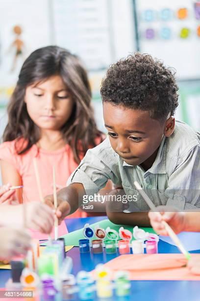 Little boy in preschool class doing art project