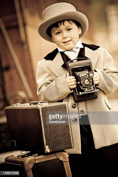 little boy in retro style with an old camera - sepia stock pictures, royalty-free photos & images