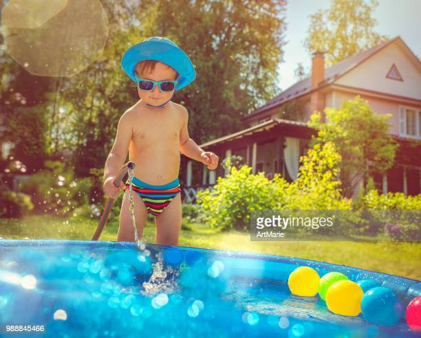 little boy in swimming pool - kids pool games stock pictures, royalty-free photos & images
