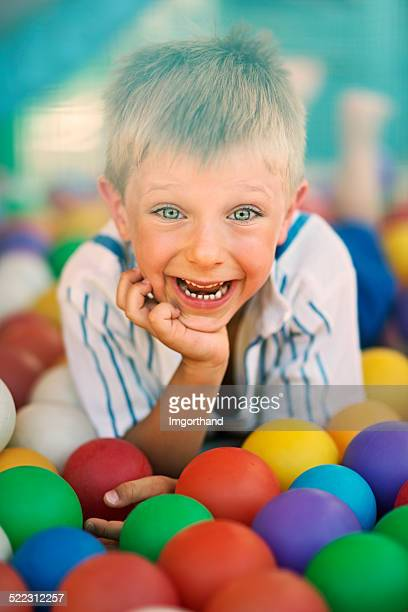 Little boy in the ball pool