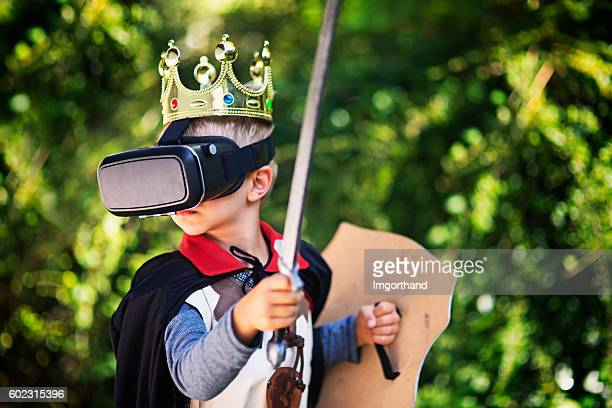 little boy in virtual reality - reality kings stock pictures, royalty-free photos & images