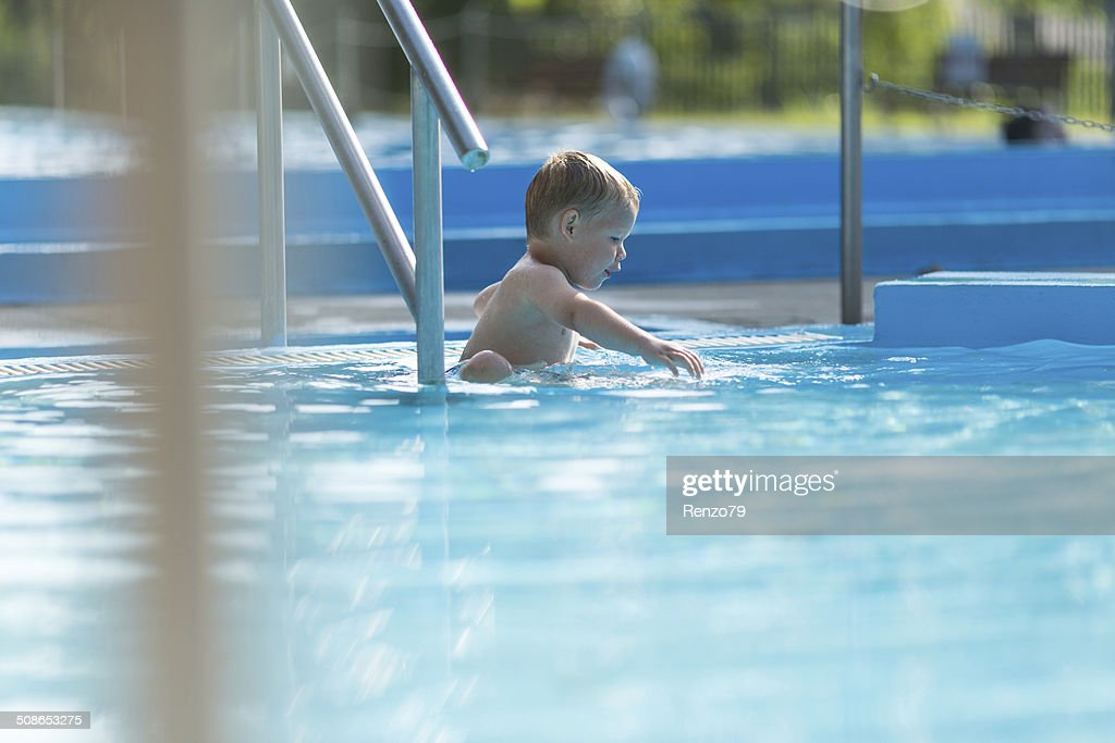 Little boy in water park : Stock Photo