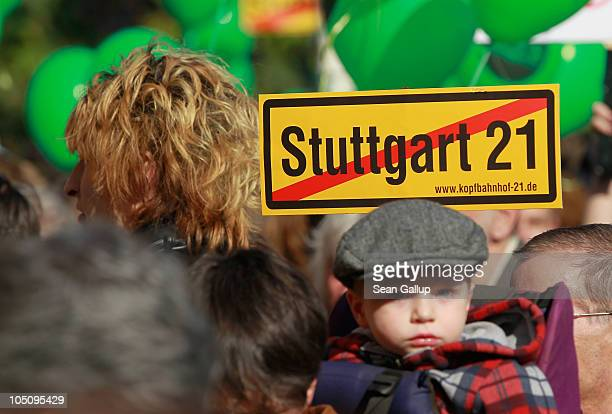 A little boy is among tens of thousands of activists marching to protest the Stuttgart 21 railway station project on October 9 2010 in Stuttgart...