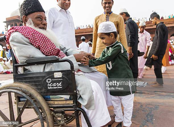 Little boy is getting blessings from an elder person after the morning prayers at the historic Jama Masjid near Red Fort in New Delhi today on the...