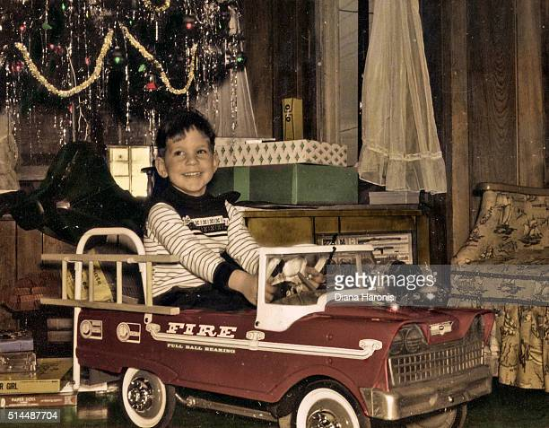a little boy is in his new, toy fire engine christmas morning. - film d'archive photos et images de collection