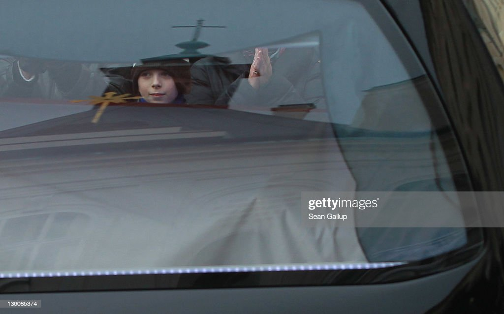 A little boy is seen though the glass windows of the hearse bearing the coffin of former Czech President Vaclav Havel away following Havel's state funeral at St. Vitus Cathedral on December 23, 2011 in Prague, Czech Republic. International heads of state and thousands of mourners came to pay their last respects to the dissident playwright who led the Velvet Revolution that forced communist rule in Czechoslovakia to crumble in 1989, and died in the early morning of December 18 in his sleep at the age of 75.