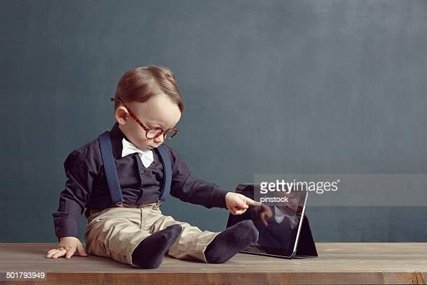 Little boy is touching digital tablet