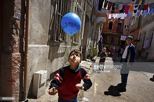 Little boy juggles with a football on the street in the district Tarlabasi on May 14, 2006 in Istanbul, Turkey. Tarlabasõ is a neighbourhood in the...