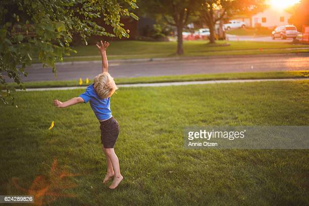 Little Boy Jumping and Reaching