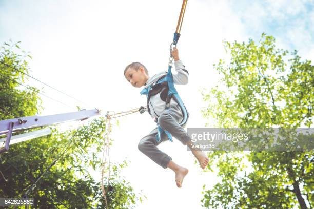 Little boy jumping at trampoline