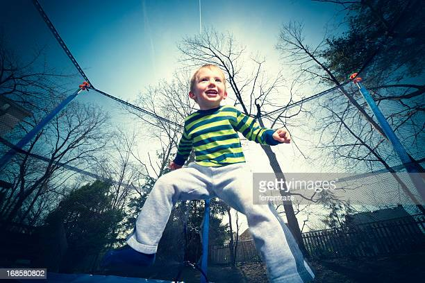 Little boy jumping on trampoline