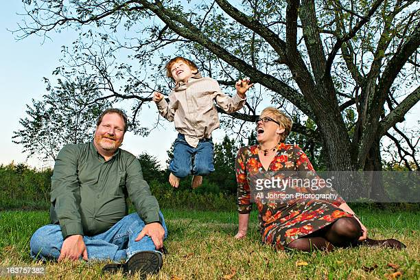 little boy jumps for joy - stockings no shoes stock pictures, royalty-free photos & images