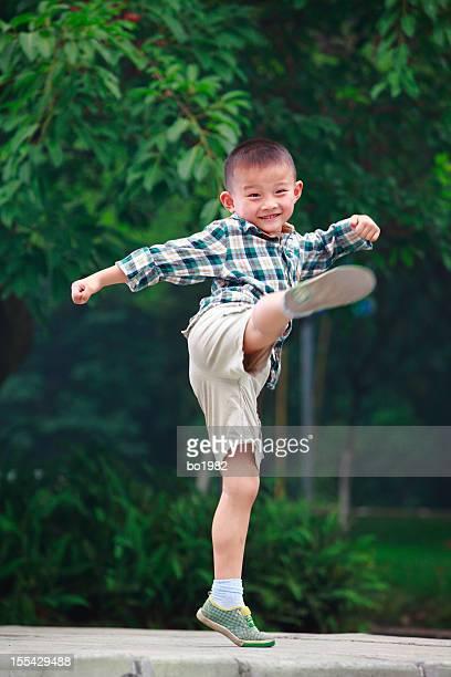 little boy kicking
