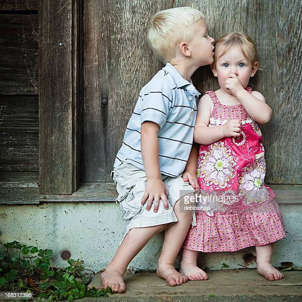 little boy kissing girl - love you stock photos and pictures