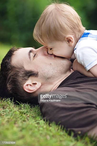 Kissing on the mouth stock photos and pictures getty images little boy kissing his daddy in grass thecheapjerseys Images
