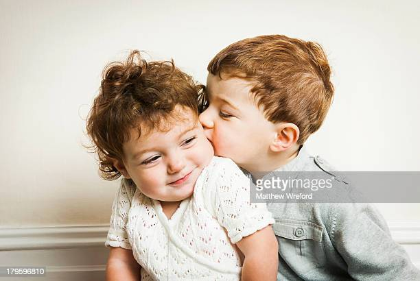 little boy kissing little girl. - affectionate stock pictures, royalty-free photos & images
