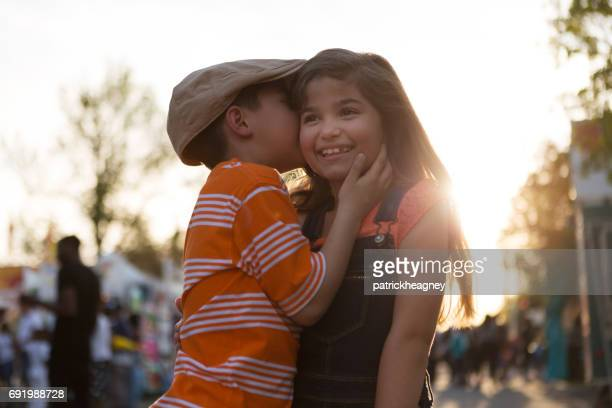 Little boy kissing little girl