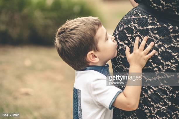 Little Boy Kissing Mothers Belly