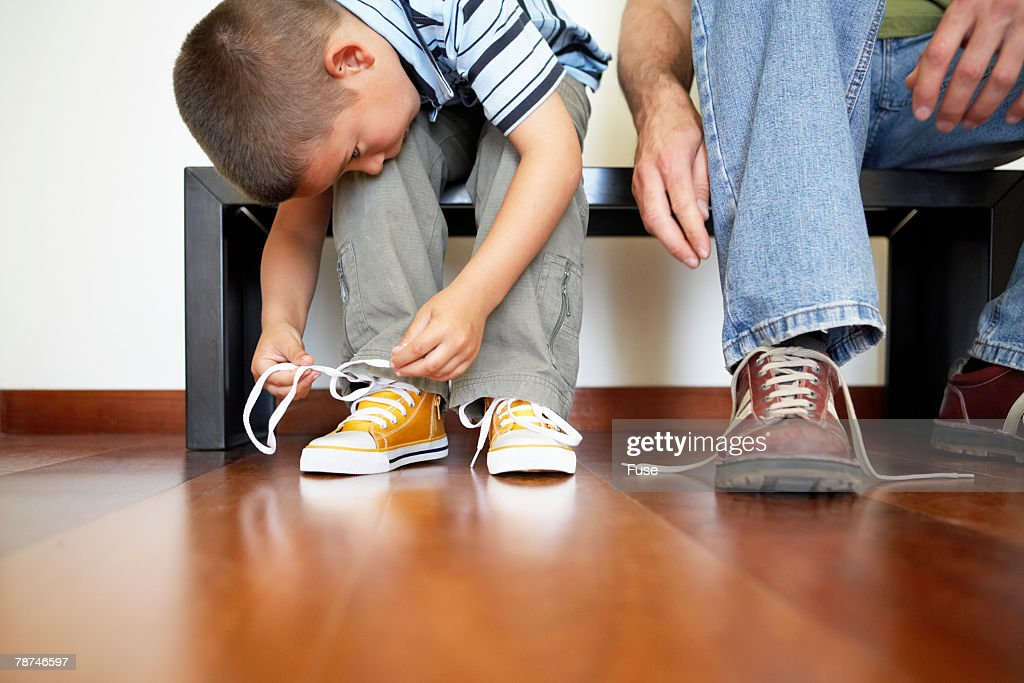 Little Boy Lacing his Shoes : Stock Photo