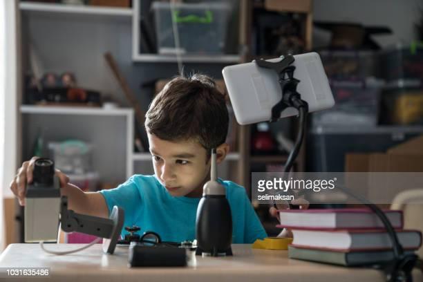 Little Boy Learning DIY For Repairing