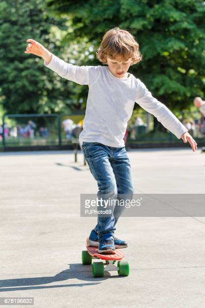 Little boy (6 years) learning skateboarding