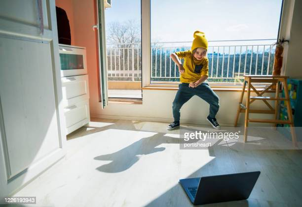 little boy learning to dance at home. home pleasures. new normal - concept. covid-19. - new normal stock pictures, royalty-free photos & images
