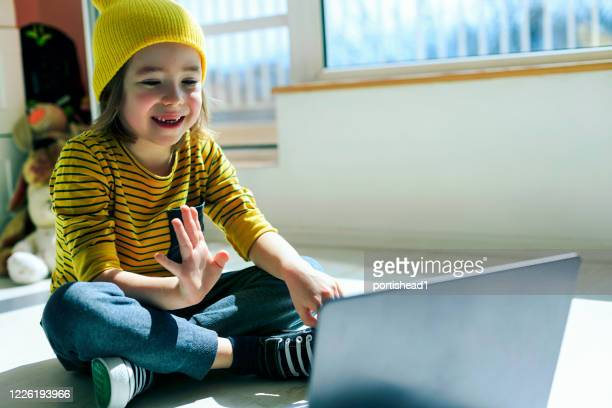little boy learning with technology at home. e-learning. new normal - concept. covid-19. - new normal stock pictures, royalty-free photos & images