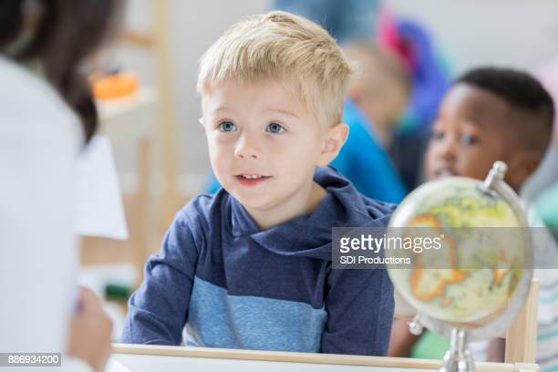 Little boy learns with flash cards at preschool