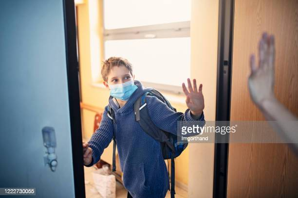 little boy leaving for school during covid-19 pandemic - leaving stock pictures, royalty-free photos & images